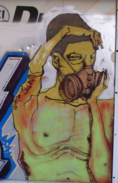 """Gas Masked Figure - """"Street Art as Social Diaries in Athens"""" By Myrto Tsilimpounidi."""