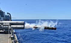 WATERS NEAR GUAM (March 23, 2015) An MK 54 exercise torpedo launches from the Arleigh Burke-class guided-missile destroyer USS Lassen (DDG 82) during Multi-Sail 2015. Multi-Sail is an annual Destroyer Squadron (DESRON) 15 exercise designed to assess combat systems, improve teamwork and increase warfighting capabilities in the Seventh Fleet area of responsibility. (U.S. Navy photo by Mass Comunication Specialist 1st Class Martin Wright/Released)