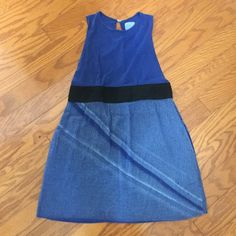 Pipit blue dress Pipit blue dress with black band at waist. Plunging or open under arm. Key hole back with hook and eye closure. Also has pockets! Pipit Dresses