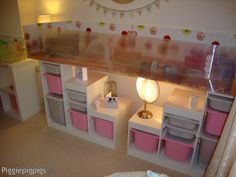 THIS IS AWESOME!! Would be perfect for L's room! Beautiful under-cage storage - and a great guinea pig cage!