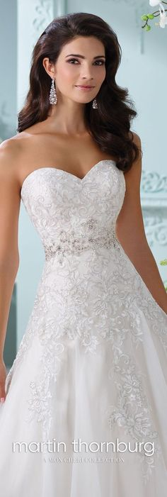 Martin Thornburg 116210 Laina - Strapless organza and lace Aline wedding dress metallic Schiffli lace appliqués over satin gown with sweetheart neckline hand-beaded jeweled motif at natural waist scalloped hem and chapel length train detachable spaghetti and halter straps included. #satinweddingdresses #wedding #weddingideas #weddings #weddingdresses #weddingdress #bridaldress #bridaldresses #weddingdressideas