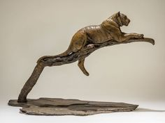 #Bronze #sculpture by #sculptor Nick Mackman titled: 'Raj at Rest, Tiger sculpture'. #NickMackman