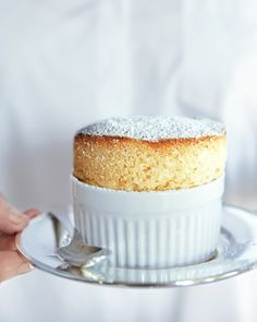 Tart citrus balances the sweet souffle batter in these single-serve souffles that are an ethereal ending to dinner.