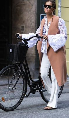 White pants + lace top + blush pink long vest