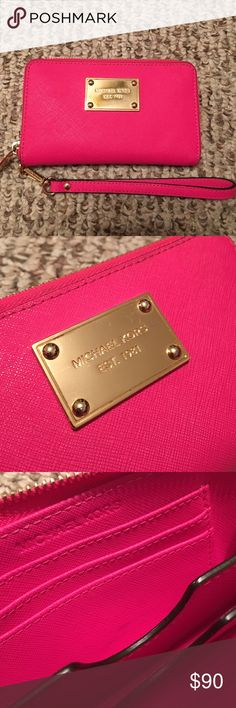 MICHAEL KORS Jet Set PINK iPhone 5/5s WRISTLET  AUTHENTIC & STUNNING! Zipper closure & detachable wristlet strap :) 3 card slots, 1 bigger pocket, and a center pocket to storage your phone! (Minor scratches & marks) Gently loved MK zippered Wristlet. Three Card Holders, One Open Pocket for change or cash. Gold toned hardware. Will fit an iPhone 5 or smaller screened phones. Great color to bring on Summer! MICHAEL Michael Kors Accessories Phone Cases