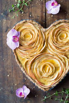 An apple rose tart that will make your loved one drop their chin! It's not only a piece of art but also absolutely delicious. A crunchy nut crust with sweet apples and maple custard, what else can you want in life?