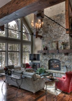 Rustic living room, love the dash of red