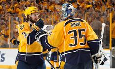 NASHVILLE, TN - JUNE 3: Pekka Rinne #35 celebrates a win with Filip Forsberg #9 of the Nashville Predators against the Pittsburgh Penguins during Game Three of the 2017 NHL Stanley Cup Final at Bridgestone Arena on June 3, 2017 in Nashville, Tennessee. (Photo by John Russell/NHLI via Getty Images)