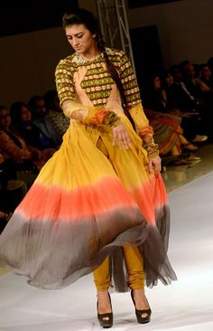 Islamabad April 11 : Models walk down the ramp during Islamabad Fashion Week 2012 at Pak China Friendship Center.