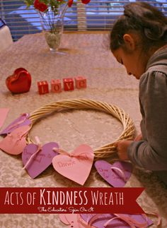Random Acts of Kindness Wreath for Kids.  Encourage your child to focus on Acts of Kindness with the family for Valentine's Day this year  from the Educators' Spin On It