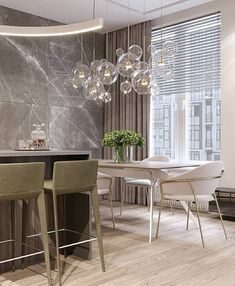 In love with this kitchen design and the way this glass chandelier compliments the room Shop our Palmina Glass Bubble Chandelier luxorhomedecorandlighting Luxe Decor, Luxury Home Decor, Luxury Interior, Modern Interior, Bubble Chandelier, Glass Chandelier, Crystal Chandeliers, Pendant Lamps, Pendant Lights