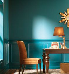 We love the way the wainscoting that's just a shade darker than the wall color adds drama, without being too busy. Crisp white wainscoting is a beautiful accent to traditional homes, but we love the way this bright shade of turquoise feels youthful but sophisticated.