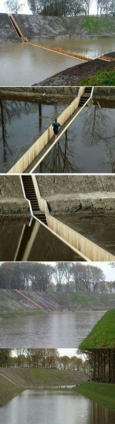 ▪◾جسر موسى  MOSES BRIDGE ◾▪   عندما يخرج المعماري عن النص !  بنى المعماريان رو كوستر و أد كيل أرتشيتكتس – Ro Koster and Ad Kil  جسر موسى غير المرئي تقريباً للعبور إلى حصن دفاعي تاريخي في قرية هالستيرن، هولندا – Halsteren.   الجسر الغارق المدهش يقع داخل المياه بشكل مميز. الجسر مصنوعة بواسطة تكنولوجيا تسمى Accsys Technologies وهي عبارة عن استخدام نوع معين من الخشب الذي يتمتع بالمرونة والصلابة في نفس الوقت وعوامل الأستدامة.