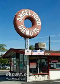 """""""Attack of the Giant Donut II"""" - Long Beach loves its giant donuts! And who wouldn't?  This majestic beast can be found on Long Beach Blvd at the corner of Roosevelt Road."""