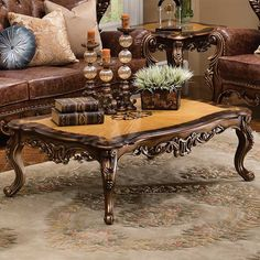 ~ Bronze and Leather Coffee Table ~ | Notice the lavish pierced carving on the front, and back of each piece. Tables have a unique two-toned top. | magnoliahall.com
