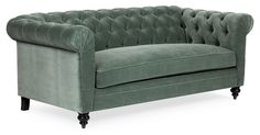From its luxe velvet upholstery to its button-tufted seat and gorgeous sage hue, we love everything about this elegant Chesterfield sofa!
