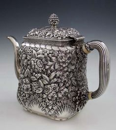 Tiffany & Co sterling silver teapot in a floral repoussé pattern, with a shell motif around the base. New York/1881 (Britannia Silver)
