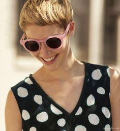 Pink sunglasses, short hair, polka dot shirt / Garance Doré