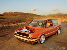 1991 Volkswagen Jetta Coupe w/ bamboo bumpers and body molding.