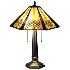 @Overstock.com - Tiffany-style 2-light Hex Mission Table Lamp - Enrich your home decor with this Tiffany-style Hex Mission table lamp. The Mission-style hex shade contains cuts of glass in shades of green, yellow, amber and orange.    http://www.overstock.com/Home-Garden/Tiffany-style-2-light-Hex-Mission-Table-Lamp/1497809/product.html?CID=214117  $78.29