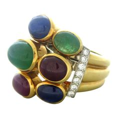 David Webb Gold Platinum Diamond Emerald Sapphire Ring | From a unique collection of vintage cocktail rings at http://www.1stdibs.com/jewelry/rings/cocktail-rings/