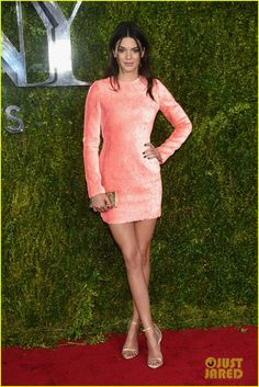 Kendall Jenner looks great in a short pink dress on the red carpet for the at the 2015 Tony Awards
