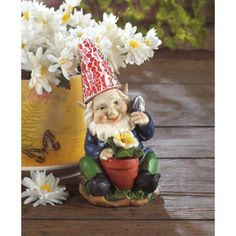 Adorable Gardening Gnome Solar Statue - Here's a happy gardener who's ready to add some cheery light to your yard. This Adorable Gardening Gnome Solar Statue is proudly tending to his yellow bloom, and his red hat will shine bright at night thanks to the statue's solar panel.