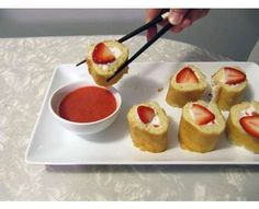 "Strawberry shortcake ""sushi"". What a cool idea for a party. Could do this with blueberries too. Or any other fruit for that matter."
