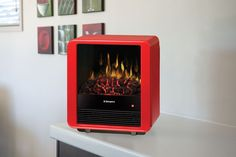 Sending a son or daughter off to college this fall? Keep them cozy with our dorm-room electric fireplace stoves. Learn more about these energy efficient, inexpensive units: www. Electric Fires, Electric Stove, Portable Electric Fireplace, Electric Fireplaces, Stove Fireplace, Cube, Home Appliances, Cool Stuff