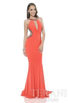 Fitted halter sheath gown with crystal embellishments along the neckline and sides. Dress is finished with a keyhole cutout at the bust.