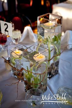 LIke the idea of various sized glass containers, flowers submerged and floating candles. Short Centerpieces, Wedding Reception Centerpieces, Centerpiece Ideas, Wedding Themes, Wedding Bouquets, Wedding Flowers, Wedding Decorations, Wedding Dress, Table Decorations