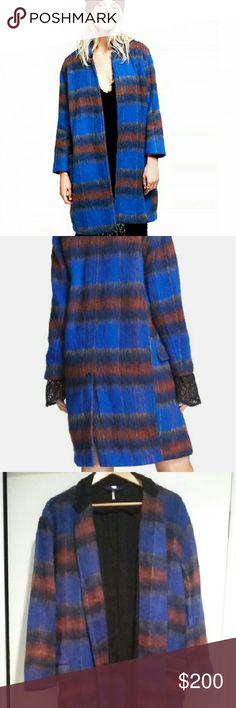 FREE PEOPLE long and lean overcoat This is a blue vibrant plaid, boho meets hipster kind of coat. It is most definitely oversized and runs big. It's lightweight and has a more of a jacket feel despite its bulky appearance. A must have for FREE PEOPLE fans. Free People Jackets & Coats Trench Coats