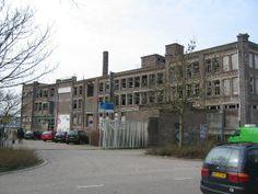 Hollandia Wol- en Kousenfabriek voor de sloop en nieuwbouw. Twee gevels zijn gedeeltelijk opgenomen in de nieuwbouw.