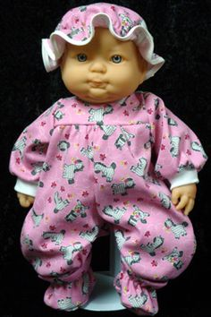 """The Pink Zebra Pajamas have long sleeves and zipper in back. Matching Night Hat. Pink Bow Diaper. Pink Panties. White Socks. Matching Booties. Matching Bib and Matching Doll Blanket measures 22"""" x 22""""."""