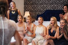 love this: candid shot of bridesmaids when bride walks out in her dress. so sweet!