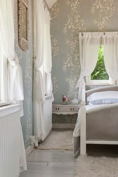 Love this! Double tab curtains with short & long so short can be closed for privacy. Love wallpaper. Soft, light, airy room.