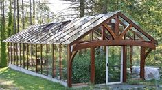 Timber framed greenhouse from salvaged western red cedar and recycled slider glass by proteamundi