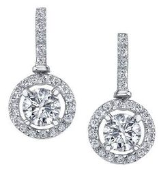 Diamond Aura Collection ~   Pure White™ 18 Karat Canadian Certified Gold diamond earrings. Set with two round brilliant cut Canadian diamonds and surrounded by round brilliant cut diamonds, totalling 0.90ctw. Also available with 0.60ctw diamonds.  ML190