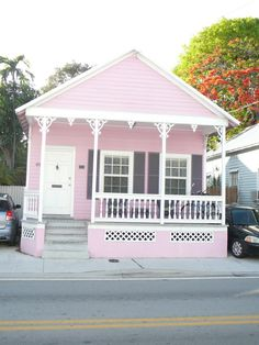 Soooo Key West ... Pretty, charming, tropical pink shot gun cottage with adorable gingerbread trim.