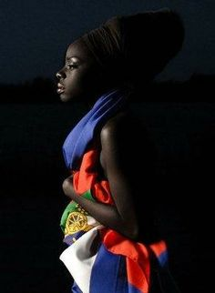 Haitian pride, women dressed with her flag.