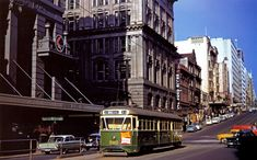 M&MTB prototype car PCC 980 crosses the intersection of Bourke and Elizabeth Streets with State Savings Bank (demolished) at rear. Circa 1960