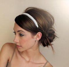 messy bun and headband.
