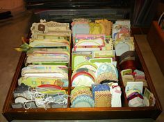 I used a small curio shelf I found at the thrift store to organize my journal boxes and tags.
