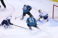 San Jose Sharks forwards Andrew Desjardins + Tommy Wingels rush in 2-on-1 against Vancouver Canucks goaltender Roberto Luongo (Oct. 3, 2013).