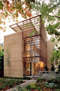 This lovely home is located in a very narrow, thirty-foot, urban lot in Seattle, Washington. It was designed to maximize access to natural light and views while maintaining privacy. Due to the small site that has three floors and a roof terrace. The south facade of the house has large expanses of glass and is protected by a sun screen of cedar.