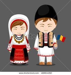 Romanians in national dress with a flag. Man and woman in traditional costume. T Romania.
