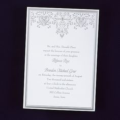 Hearts And Vines wedding invitations features a bright white invitation card features a rich silver border with silver heart and filigree design at the top with gold accents. Brides wedding invitation ideas list favorite!