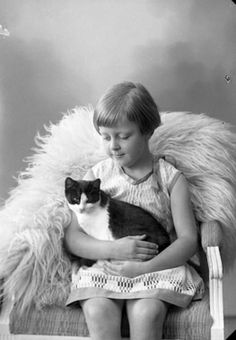c. 1920 (Photo by Ingeborg Enander)  This is beautiful....The look on her face   ..is love for her kitty cat..♥ ♥ ♥