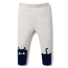 Cotton/Elastane. Full length legging. Features kitty placement print on lower legs on front and back with self covered elasticated waistband. Slim fitting silhouette. Available in Oatmeal.
