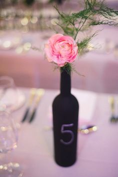 Use wine bottles for your table numbers. Using chalkboard paint and a bottle of wine! Make your own chalkboard wine bottle table numbers. Chalkboard Wine Bottles, Painted Wine Bottles, Chalkboard Paint, Blackboard Wedding, Sweet Woodruff, Wedding 2015, Wedding Ideas, Wedding Table Decorations, Centre Pieces